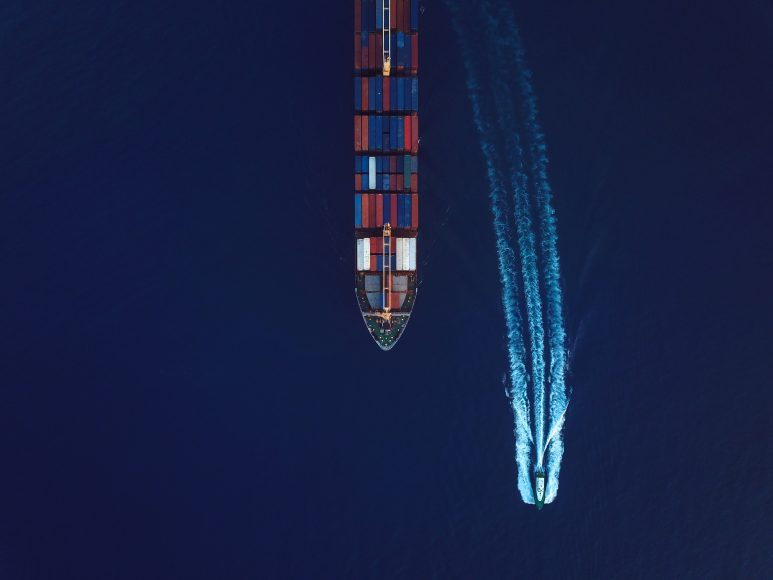 Aerial View Of An Industrial Ship On The Move.